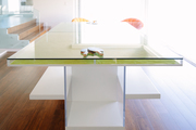 A glass ping pong table with layers for storage.