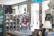 Rugs, art, and furniture on display in a retail environment