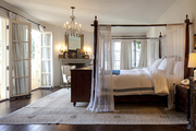 A romantic master bedroom with Persian rug