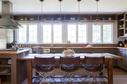 Director-style chairs surrounding a wooden dining table in a kitchen