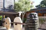 A stone water feature and sculptures in the courtyard at Napa Valley's Bardessono hotel