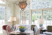 A Venetian chandelier above an antique breakfast table