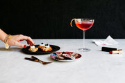 A Campari-Lillet cocktail paired with oysters and cauliflower fritters topped with caviar