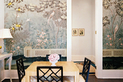 Scenic Gracie wallpaper in a dining space with a square table and black fretwork chairs
