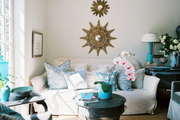 A trio of starburst mirrors above a white couch