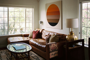 Vintage living and lounge space with leather sofa and wall art.