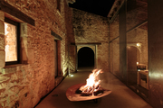 A modernist fire pit in a glass-and-stone-walled restaurant