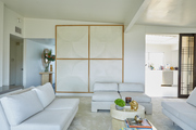 A living room with matching white sofas and white decor.
