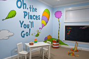 A Dr. Seuss mural brightens up this play room.