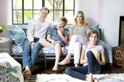 Designer Tami Ramsay and family on a sofa in their redone living room