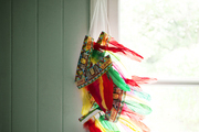 Feather headdresses hung from a window frame