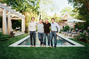 Drew Frist, Jack DeLashmet, David Cafiero, and Tom Dolby outside Frist and Dolby's Hamptons home