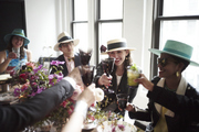 Guests toast to a festive Kentucky Derby party