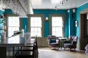Bright blue walls line the bar at The Maidstone