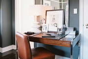 A leather chair paired with a wood desk