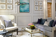 A traditional living room in a white and gray palette.