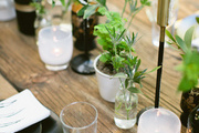 A rustic tablescape with greenery.