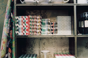 Notebooks and ceramic teapots arranged on shelves