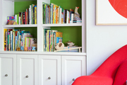 Books and toys arranged on white built-in shelves