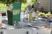Floral table cloth atop outdoor dining table.