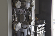 A unique storage system for cookware in a small kitchen