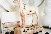 A white table decorated with a horse figurine