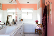 Pink bathroom with white tiles.