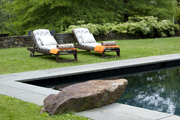 Two chaise lounges beside a built-in pool