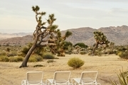 Lounge chairs in the desert.