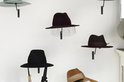 Hats hang on the wall of a Kentucky Derby party in the city