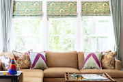 A Barbara Barry sectional and Serena & Lily window treatments in a family den