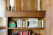Here are a few filled shelves next to the stairs.