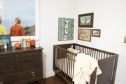 This is a nursery with vintage wooden furniture.