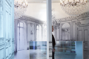 Elaborate chandeliers hung above a trompe l'oeil carpet runner