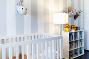 Stripes and black flooring in a bright, fun nursery.