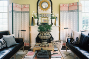 Decorative screens flanking a white mantel