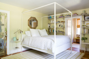 A yellow bedroom with rustic touches