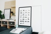 A white, black, and neutral work space with boho and modern touches.