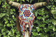 A beaded Southwestern reference hung in a garden