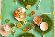 A tablescape of greenery and flowers
