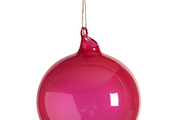 An alluringly reflective red-raspberry globe ornament