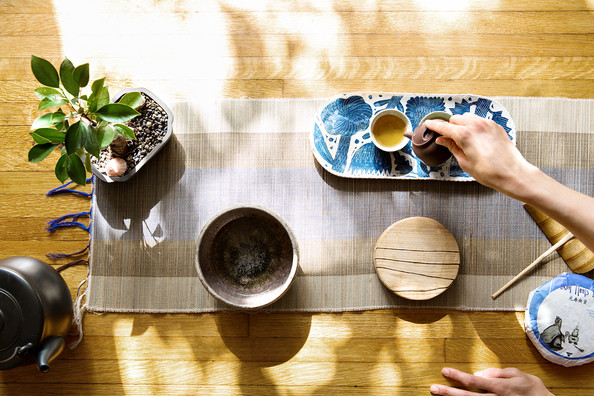 Asian - A tea service set atop a hardwood floor.