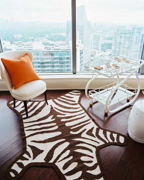 Bar Cart - A white bar cart and a zebra-print rug beside a garden stool