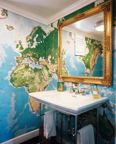 Bathroom - Map wallpaper and a gold mirror in a bathroom