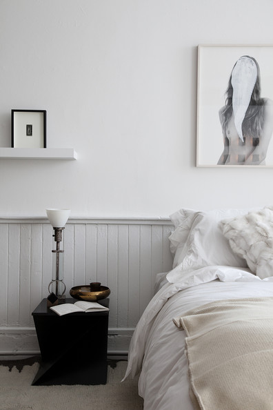 bedroom white painted beadboard and wall with framed artwork in a