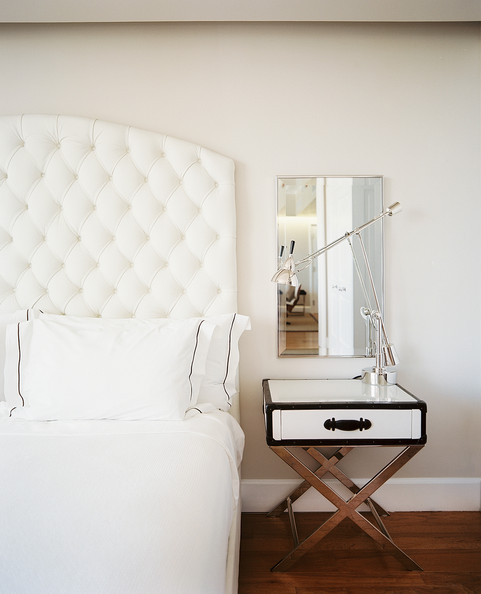 Bedroom - A white tufted headboard in a neutral guest room