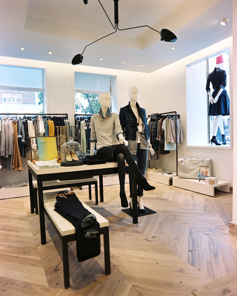 Ladies clothing store with collection of summer clothing fitted on