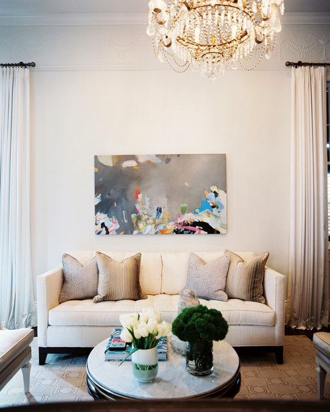 beige living room a white couch paired with a round coffee table and