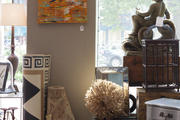 Rugs, art, and decorative objects on display in a retail environment