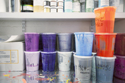 Wallpaper-production supplies on open shelves
